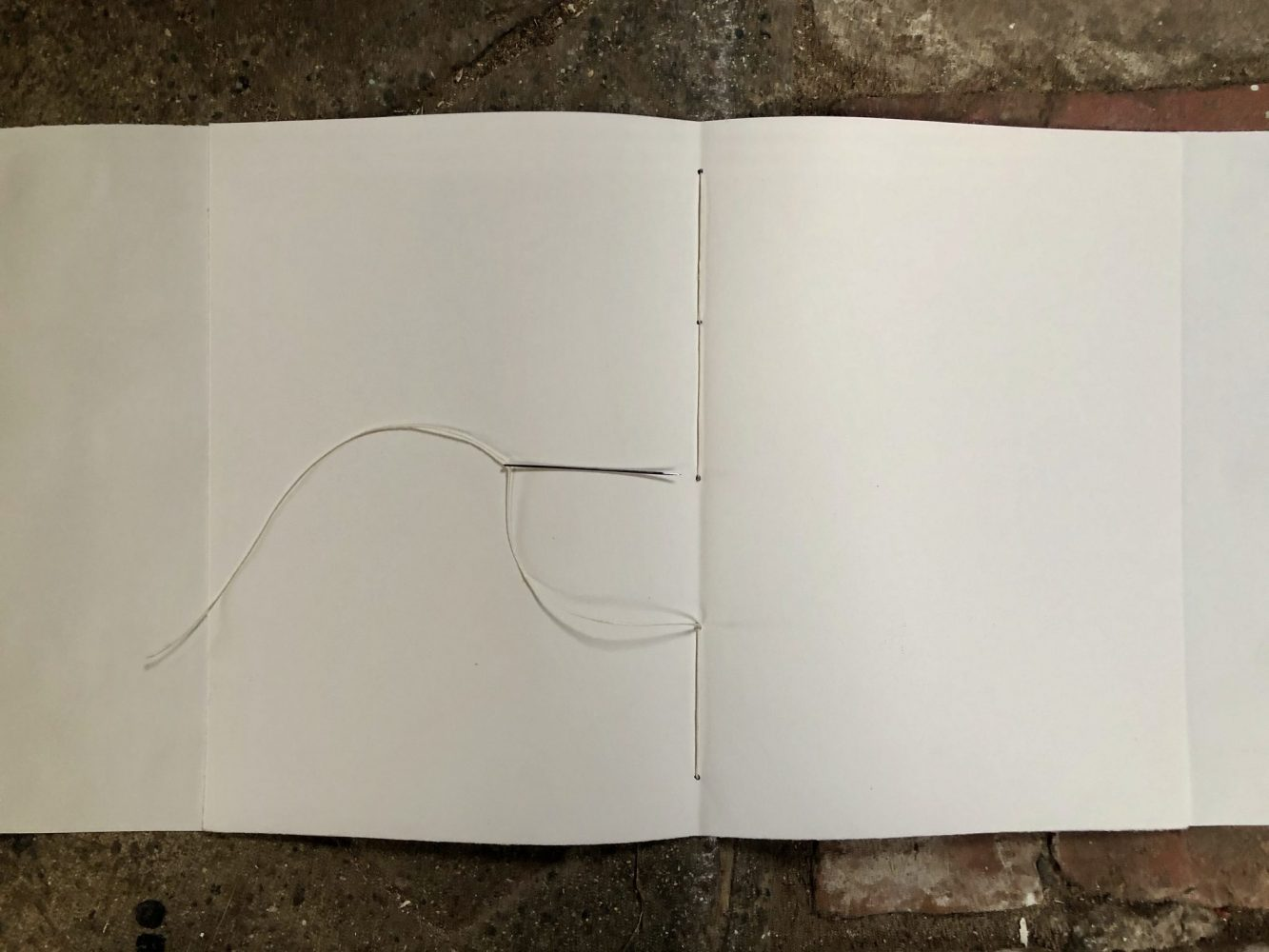 Make a journal - step twelve - back through the middle hole