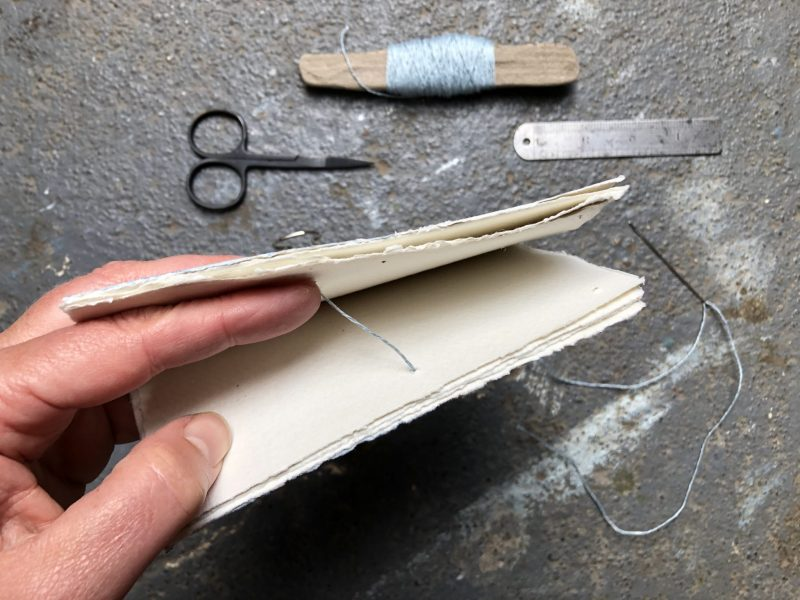 Make a stab binding with The Travelling Bookbinder - Start in the middle