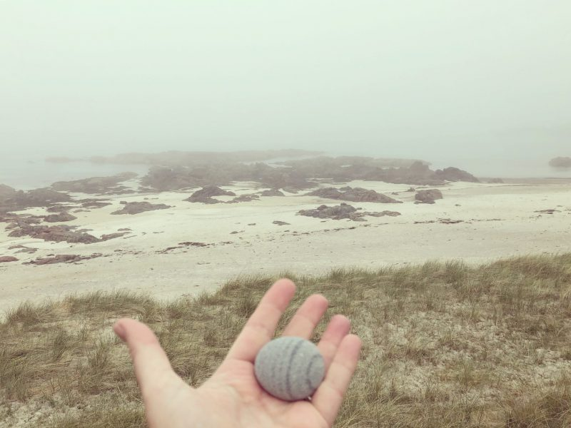 Carrying a pebble. Isle of Iona. Inner Hebrides. Island isolation: Creative lockdown.