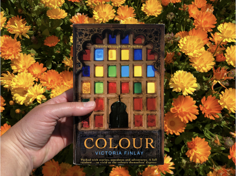 The Travelling Bookbinder: Book Review. Colour by Victoria Hyslop. Photographed in a bed of marigolds by Rachel Hazell